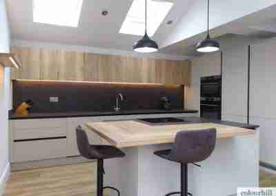 True handle-less kitchen in taupe grey with feature oak